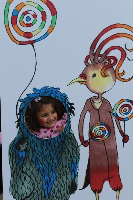A child becoming a little monster at Tamer's booth during the International Palestine book fair 2014. Photo: Tamer Institute