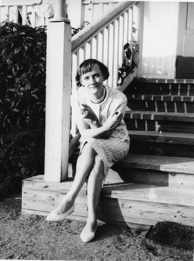 Astrid Lindgrens on the stairs of her childhood home at Näs, Vimmerby.
